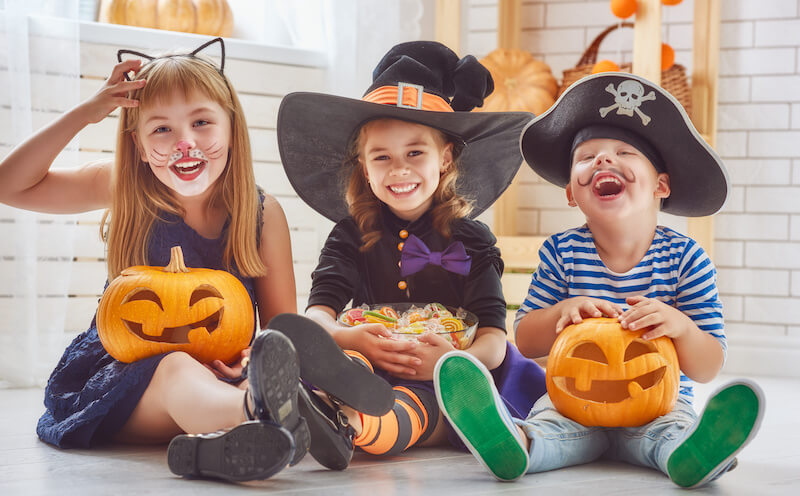 Happy kids in costumes - Halloween Safety